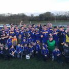 Easkey players, management and supporters celebrate after winning their All-Ireland Junior Club Championship semi-final with Red Hughs in Ballinamore on Sunday