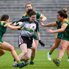Emma Keavney of Sligo in action against Meath's Niamh Gallogly and Shauna Ennis in the Lidl NFL league final. Pic: Oliver McVeigh/Sportsfile