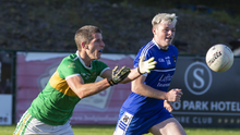 Adrian McIntyre of Tourlestrane in action with Geevagh's Donal Conlon in Connolly Park. Pic: Donal Hackett