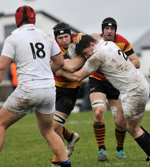 Kuba Wojtkowicz, back, for Sligo RFC, powers forward
