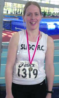 Pauline Henry, Sligo AC with her winner's medal from the senior women's 400m event at the Connaught Indoor Championships in Athlone on Sunday last.