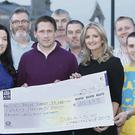 Participants from the Dublin to Sligo Charity Cycle 2013 pictured at the presentation of the cheque to Cancer Care Support Centre. Front row: Margaret Bolton, Caroline McLaughlin, Mark Boland, Lorraine McDonnell, JD Herity and Willie McCann. Back Row: Nicholas Leonard, Nivard Whelan, Con Lee, Peter Devaney and Ken O'Neill.