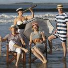 Scott Reid, Michelle Henry, Jana Dresse and Shane O'Doherty in Victorian swim costumes at the launch of the 2014 Metalman Swim Series.