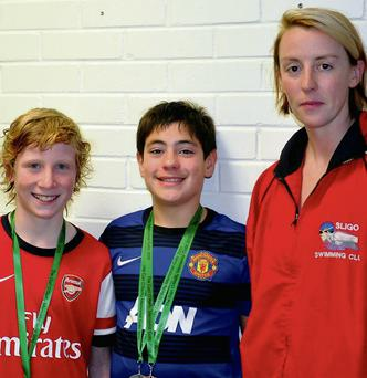 Orin Mitchell and Rowan Elliott, members of Sligo Swimming Club who were medal winners at the Ballina Gala, pictured with coach, Shiela Ryan.