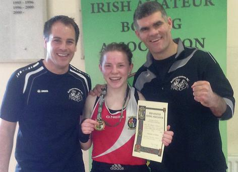 Saidhbh Greene, Ballinacarrow Boxing Club,the recently crowned Irish U-18 champion, pictured with coaches, Kevin Mullen and Stephen Reynolds.