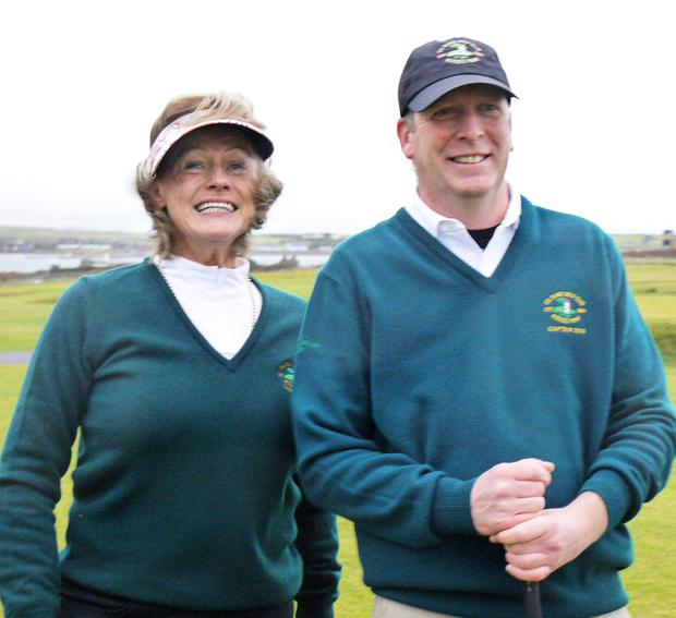Lady Captain, Carmel Hatt, and Mens' Captain, Aidan Doyle, pictured at their 'drive-in' on New Year's Day at County Sligo Golf Club, Rosses Point.