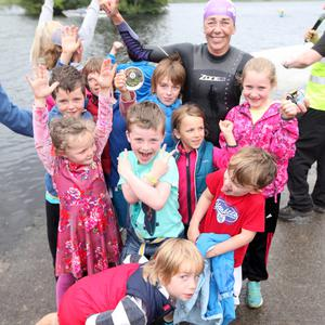 Emma Keane with her supporters at the finish of the Lough Gill Swim last Saturday