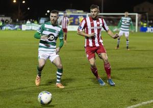 Derry's Alex Cooper in action against Jack Byrne of Shamrock Rovers. Pic: Donal Hackett