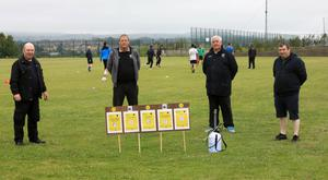 Carbury officials with Covid-19 signage, as required to return to training. Pics: Carl Brennan