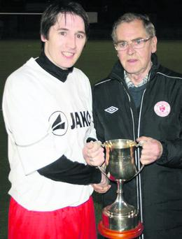Forest Celtic captain, Kenny Appleby receiving the Emmet O'Connor Memorial Cup from Emmet's dad, Martin O'Connor at the Sligo Rovers Astro Turf final.
