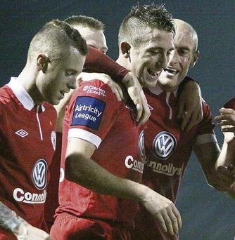 Iarfhlaith Davoren is congratulated by team mates after scoring Rovers second goal against Shels at the Showgrounds last Friday.