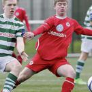 Colm Nevin wins this race for possession for Sligo Rovers against Shamrock Rovers in the U19 Elite League clash.