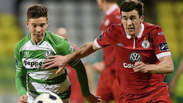 Luke Byrne, Shamrock Rovers, in action against Aaron Greene, Sligo Rovers.