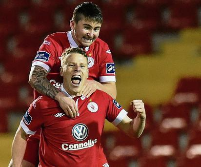 Danny North, bottom, Sligo Rovers, celebrates after scoring his side's first goal with team-mate Sean Maguire