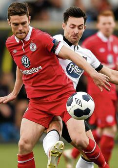 John Russell, Sligo Rovers, keeps hold of possession against Richie Towell, Dundalk during the FAI Ford Cup Second Round clash at Oriel Park in Dundalk.
