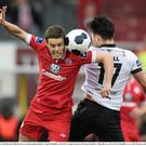 John Russell of Sligo Rovers challenges Dundalk's Richie Towell