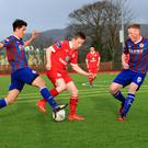 Sligo Rovers defender Ryan O'Donoghue comes under pressure from two St Pat's players during Saturday's Enda McGill Cup Quarter Final at the Sean Fallon Centre