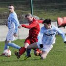 Cian Higgins of Aughanagh Celtic in action with Simon Gilmartin, Ballisodare United. Pic: Carl Brennan