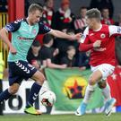 Daniel Kearns attempts to dispossess Derry City's Lukas Schubert. Pic: Carl Brennan