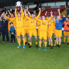Players and coaches from Manor Rangers celebrate after winning the Northwest Hospice final after defeating Ballisodare 3-2 in the Showgrounds on Saturday
