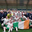 Ballymote's Mark Irwin with his teammates on the Irish national Garda soccer team who beat Norway to qualify for the Euros