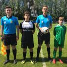 Match officials with Coola PPS captain and goalscorer Sam Tuohy and Dublin Oak Academy's Diego Sierra.