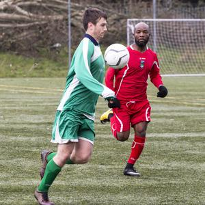 Sean Walsh of Coolaney Utd in action with St John's Joe Likindje. Pic: Donal Hackett