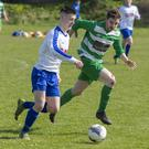 Merville's Tyler Stallard in action with Steven Armstrong of MCR on Sunday. Pic: Donal Hackett