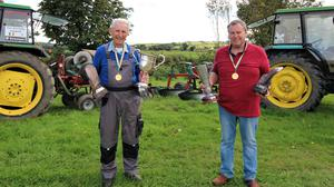Ploughing Championship Champs :Father and Son, Billy and Dan Donnelly with their winning trophies and medals at their farm in Kilmuckrdige. Dan is also the current European Reversible Champion.