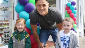 Ella and Evan Wall with Wexford hurler Lee Chin at the official opening of Loftus Allcare Pharmacy in Bunclody recently. PHOTO BY JOHN WALSH