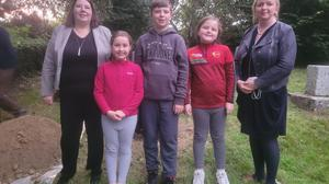 Clonegal NS pupils Darcy, Jamie and Sophie Gray attending the Time Capsule Ceremony at Cranavane Well, Kildavin with Principal Mary Gallagher and Committee member Margaret Doyle.