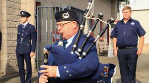 Station officer John Cullen playing the pipes at the offical opening of the memorial garden at Gorey Fire Station.