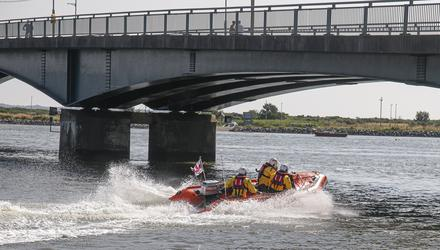 Crew members Frank O'Brien, Dermot Whelan and Robbie Conolly head across the harbour.