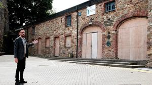 Cllr Leonard Kelly pictured at the boarded up Westgate Heritage Centre last year.