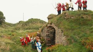 The Battle of Baginbun gets underway at the medieval fortifications at Baginbun.