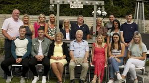 Larry Whelan is pictured with his wife and family at Saltmills where he celebrated his 80th birthday.