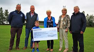 Peadar Whitty, Paddy Redmond and Cathal Brisco presenting their fundraising cheque to Marian Deering, Betty Shortle and Paddy Kavanagh from North Wexford Hospice Nursing Trust at Craanford GAA grounds