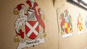 Family crests on Cooke's Lane.