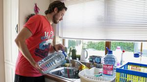Colm Lindsay, Old Airport Road, Castlebridge, using bottled water to do his washing up when the water was off last week.