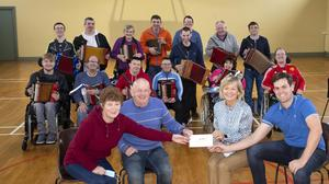Liz and Jack Harte present Liam Murray and Ann Bates with their award for work with the Cumas band.