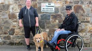 Visually impaired Yvonne Weaver with John Murphy shows the clearly marked No Parking signs at St Michaels road, Gorey.