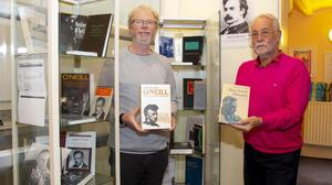 Tomás Kavanagh festival director and Sean Reidy chairperson of O'Neill Ancestral Trust with the books.