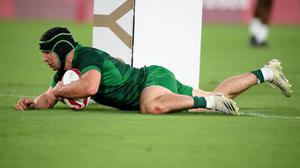 Foster Horan going over for a try for Ireland in the Rugby Sevens game against the USA.