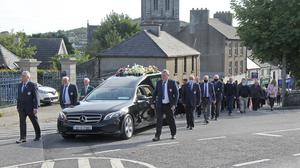 The funeral of Michael 'Mick' Quigley.