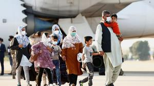 An Afghan family preparing to leave Kabul. Others were not so lucky.
