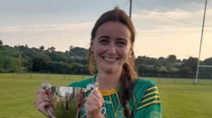 Aisling Byrne of St. Brigid's with the spoils of victory.