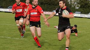 Enniscorthy's David Dwyer powers his way to the line to score a try.
