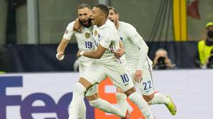 Karim Benzema and Kylian Mbappe celebrate after France's winning goal against Spain.
