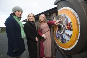 Orla Woods of Fáilte Ireland and Siobhan O'Neill, Wexford County Council with Danielle Reck, tour guide, with the new sign at the Heritage Park.