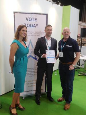 Pillar Healthcare Managing Director, Mark Whitney (centre), accepts the 'Best Supplement & Herbal' product award at The Pharmacy Show held in the NEC, Birmingham.